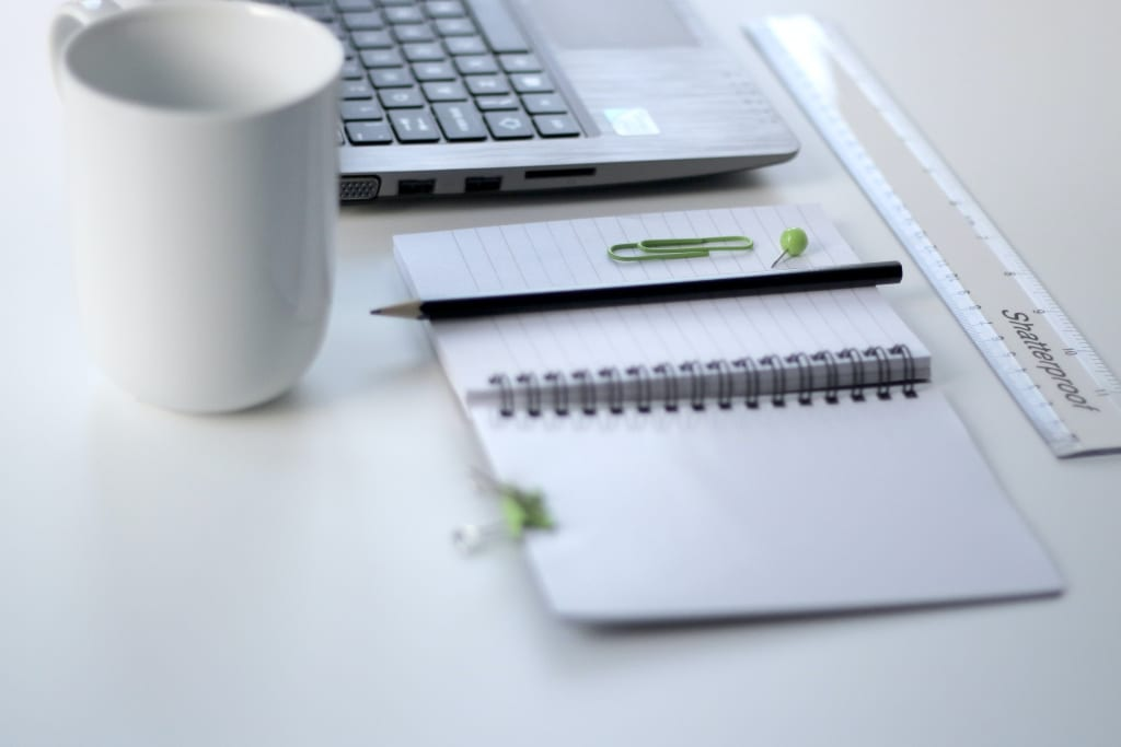 Notebook, coffee cup, laptop